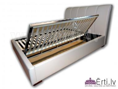 Minoti B - Eleganta eko-ādas gulta ar veļaskasti