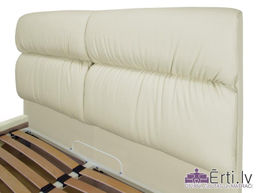 Oxford plus – Eko-ādas gulta ar veļaskasti, kuras galvaglis nodrošina ērtu galvas atbalstu