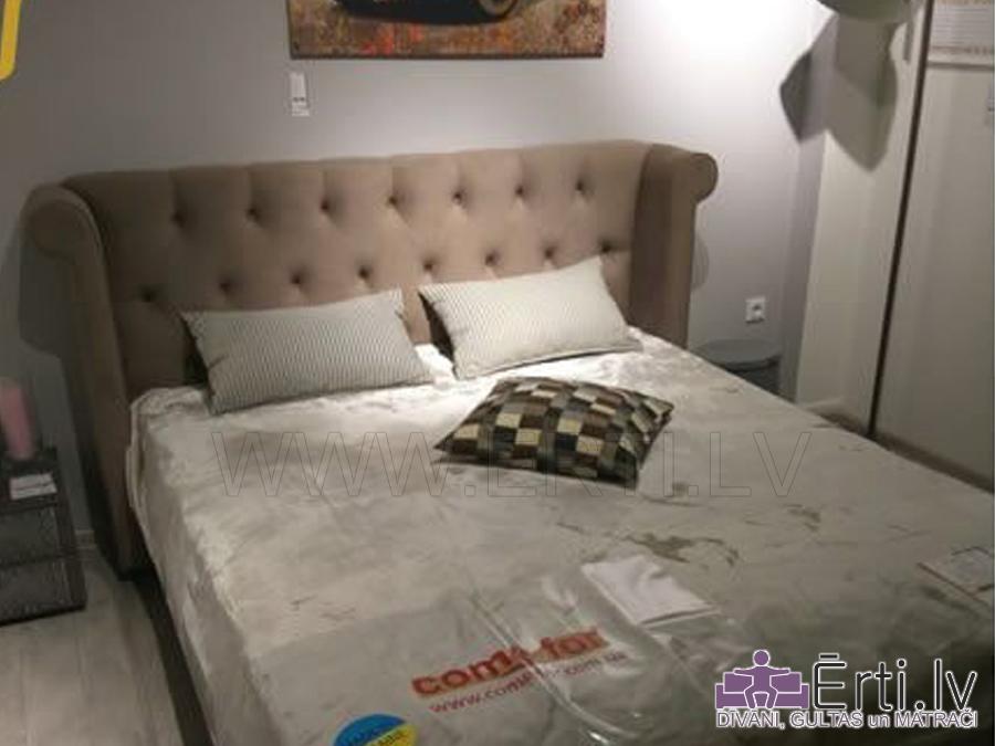 Gulta GLORA – Izsmalcināta auduma gulta ar veļas kasti
